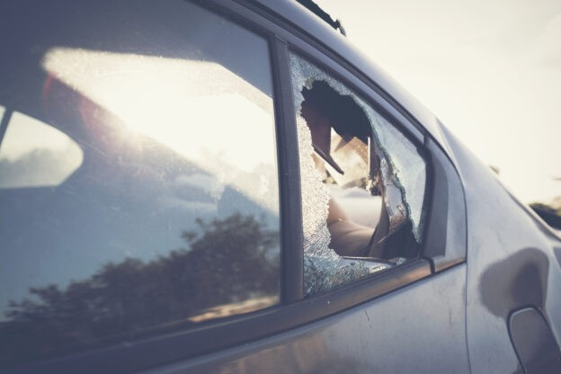 American Eagle Auto Glass appraises the cost for a replacement job on a broken car window
